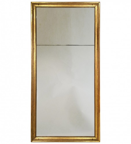 A rectangular Louis XVI giltwood mirror