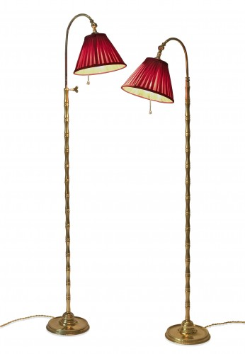 A pair of gilt brass floor lamps circa 1950