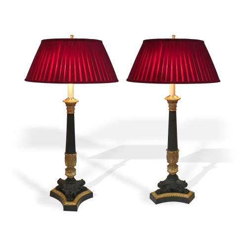 A pair of gilded and patinated tripod lamps, circa 1850
