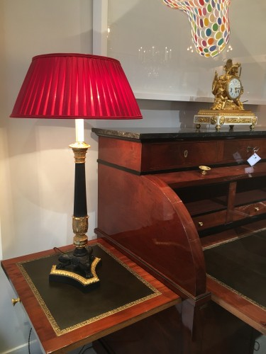 A pair of gilded and patinated tripod lamps, circa 1850 -