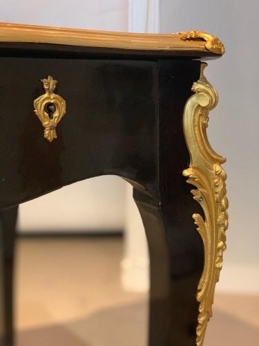 A double sided ormolu mounted ebonised desk. Late 19th century -