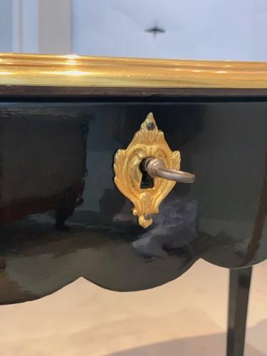 19th century - A double sided ormolu mounted ebonised desk. Late 19th century