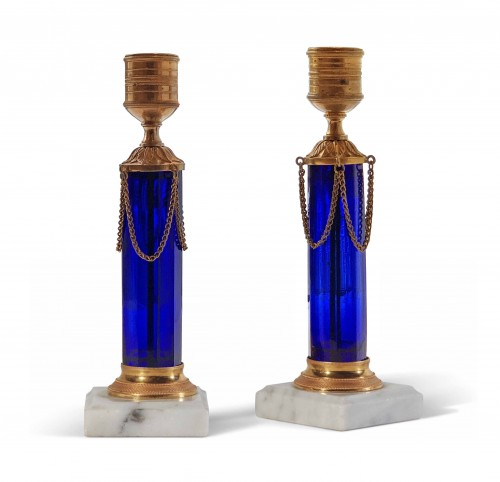 A pair of Swedish ormolu mounted cobalt blue glass candlesticks