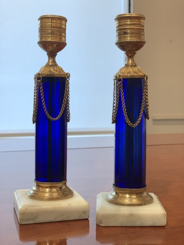 A pair of Swedish ormolu mounted cobalt blue glass candlesticks -