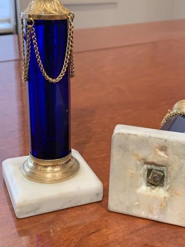 - A pair of Swedish ormolu mounted cobalt blue glass candlesticks