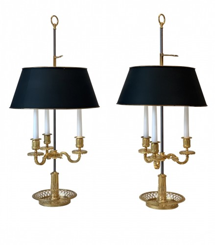 A pair of French gilt bronze and painted tole bouillotte lamps