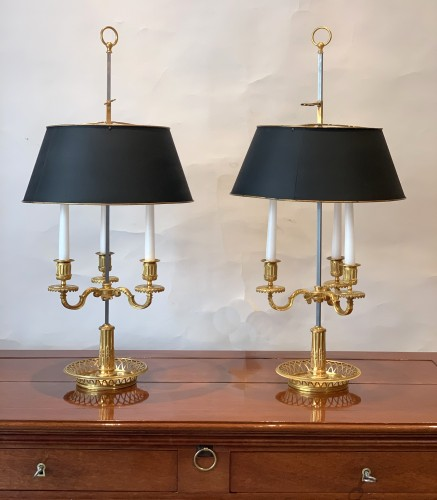 Lighting  - A pair of French gilt bronze and painted tole bouillotte lamps
