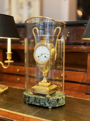 A gilt-bronze mantel clock, Empire, early 19th century - Clocks Style Empire