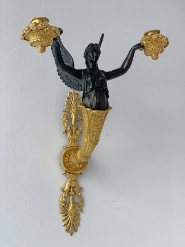 A pair of two-light Empire ormolu wall-lights attributed to Claude Galle -