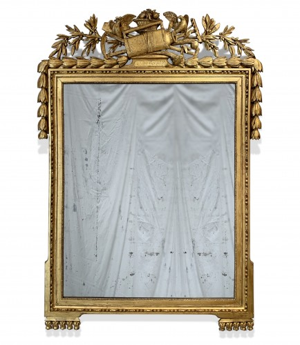 A large Louis XVI rectangular giltwood mirror