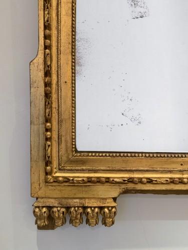 A large Louis XVI rectangular giltwood mirror  -