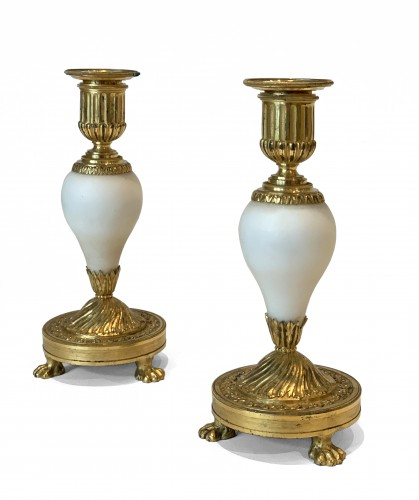 A pair of Louis XVI ormolu mounted Carrara marble candlesticks