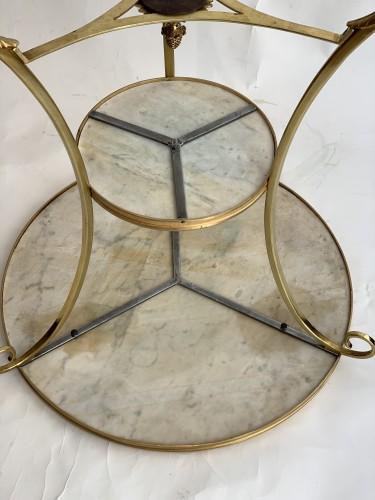 - A neoclassical gilt-bronze gueridon with Carrara marble top
