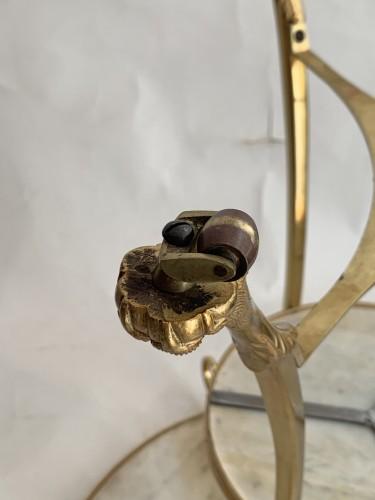 Antiquités - A neoclassical gilt-bronze gueridon with Carrara marble top