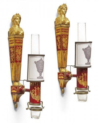A pair of late 18th century gilt metal and scarlet tole peinte wall lights