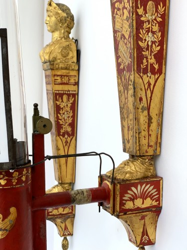 A pair of late 18th century gilt metal and scarlet tole peinte wall lights  -