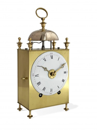 A Louis XVI brass capucine clock