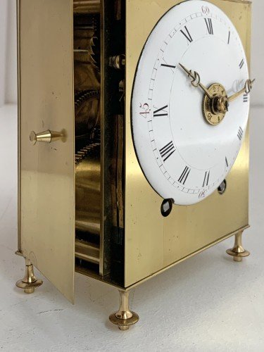 Horology  - A Louis XVI brass capucine clock