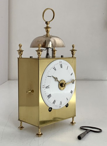 A Louis XVI brass capucine clock -