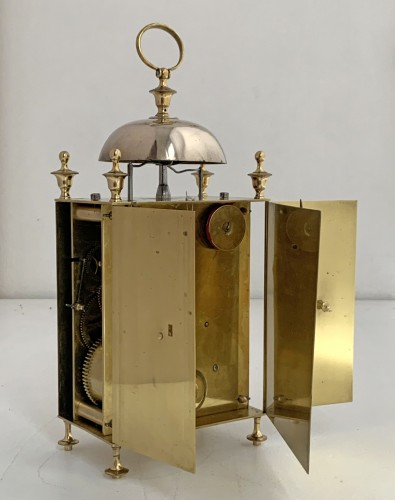 - A Louis XVI brass capucine clock