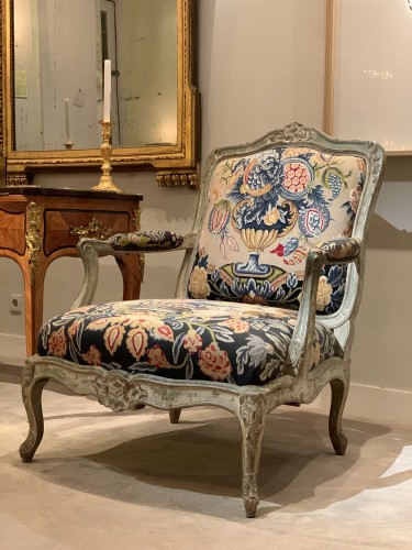 - A pair of large fauteuils à la reine upholstered a châssis