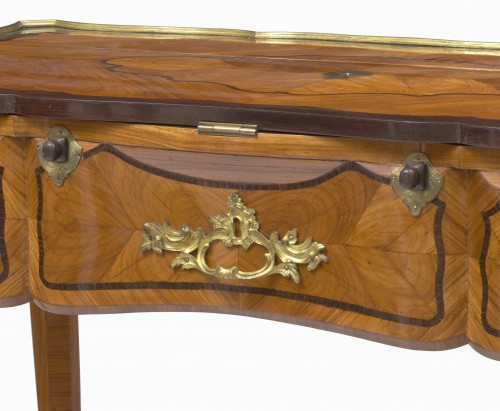 A Louis XV ormolu-mounted tulipwood and amaranth desk -