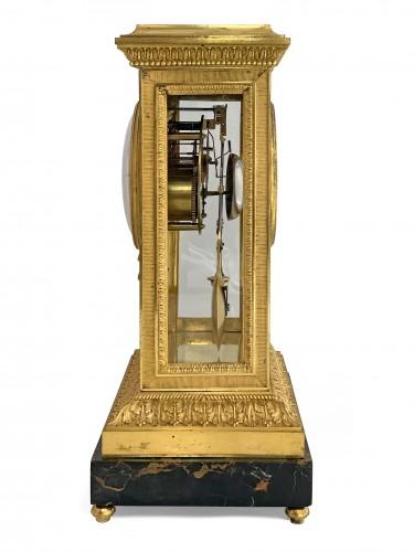 18th century - Manière - Merlet - Thomire. An important gilt-bronze mantel regulator