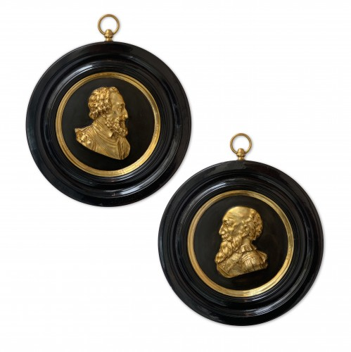 A pair of bronze portrait medallions on Henri IV and Sully