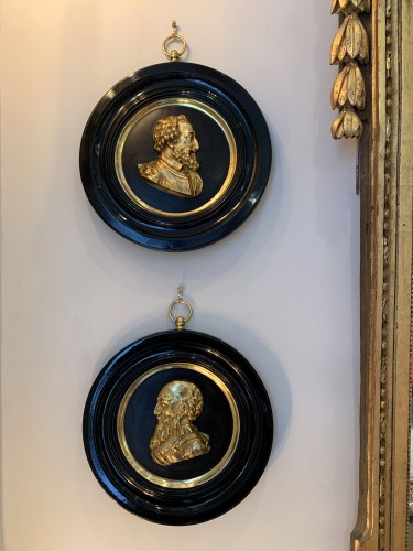 A pair of bronze portrait medallions on Henri IV and Sully -