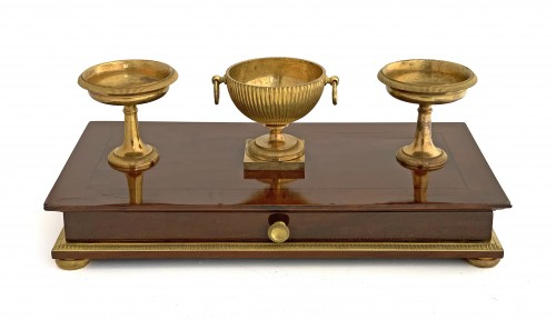 An Empire ormolu mounted mahogany inkstand