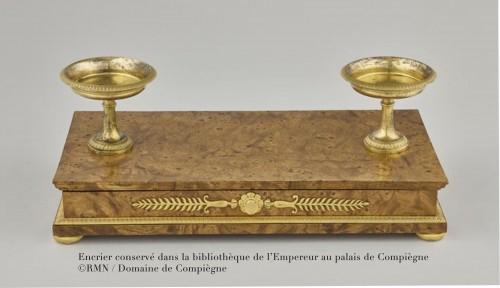 An Empire ormolu mounted mahogany inkstand -