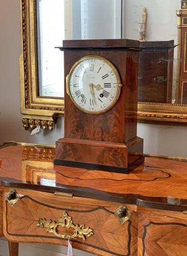 - Jean Antoine Voisin - A large mahogany clock