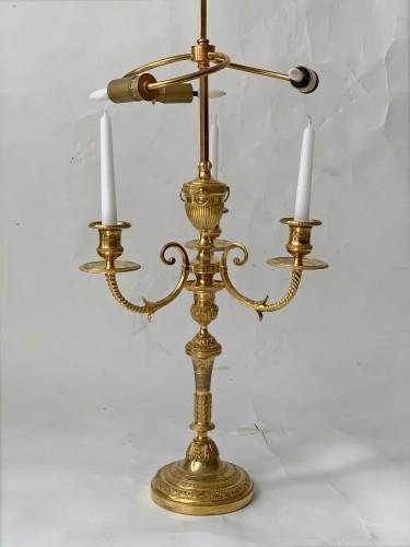 Antiquités - A pair of three-light Directoire ormolu bouillotte lamps