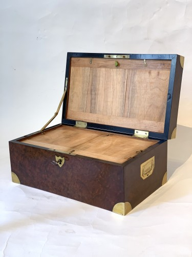 A brass inlaid and gilded bronze Empire amboyna burl casket -