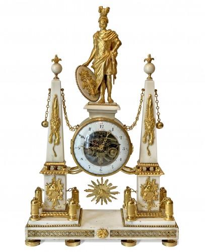 A large Louis XVI ormolu mounted white marble portico clock
