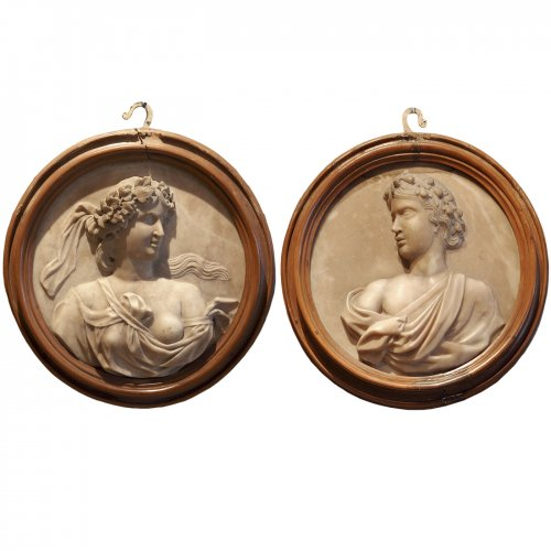 Pair of alabaster medallions