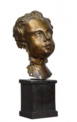 Putto head in gilded copper