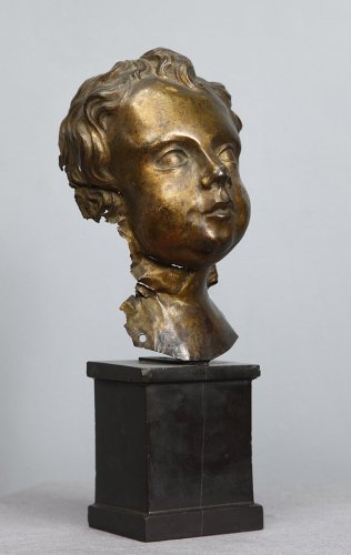 Putto head in gilded copper -