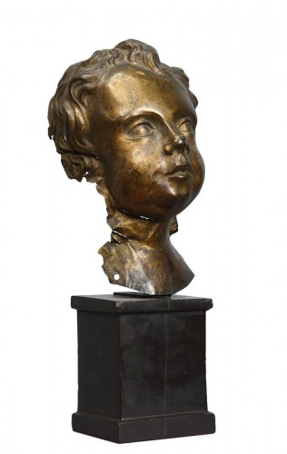 Head of Putto in gilded copper, Italy 17th century