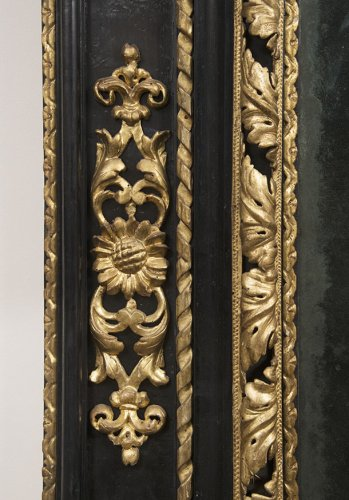 A late 17th century Italian blackened wood and Parcel Gilt Mirror -