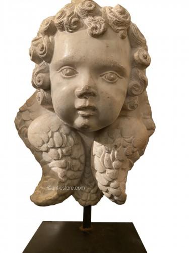 Head of cherub in white marble