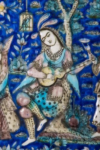 Tile representing a gallant scene in a garden -