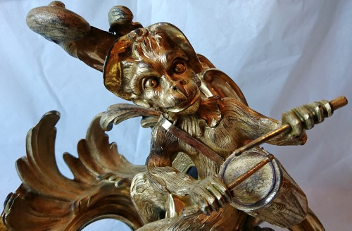Antiquités - A pair of Louis XV period ormolu andirons, model by Caffieri