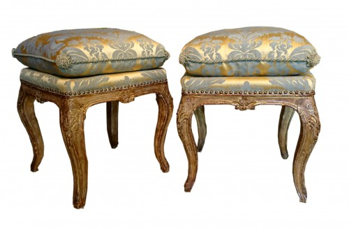 A pair of North Italian carved and gilt wood square stools, circa 1750