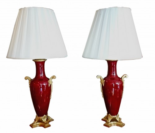 A pair of large French Napoleon III period sang de boeuf lamps