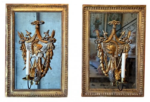 A pair of North Italian gilt wood trophies on mirror, circa 1780