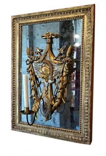 A pair of North Italian gilt wood trophies on mirror, circa 1780 -