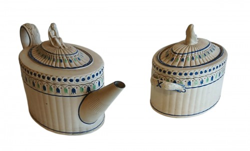 A stoneware with overglaze decoration teapot and sugar pot, Turner