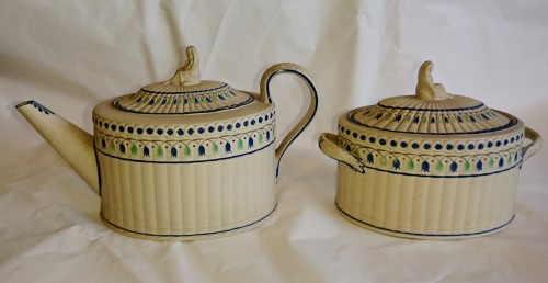 A stoneware with overglaze decoration teapot and sugar pot, Turner -