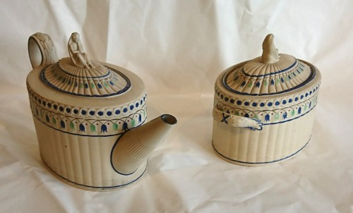 A stoneware with overglaze decoration teapot and sugar pot, Turner - Directoire
